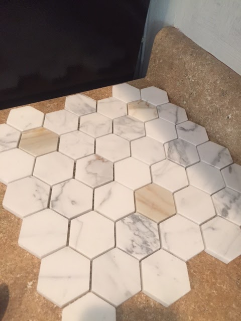 Calacatta Gold marble hexagon mosaic tile from the Builder Depot