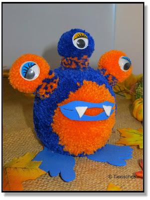 Monster aus Bommeln / Pompons gebastelt