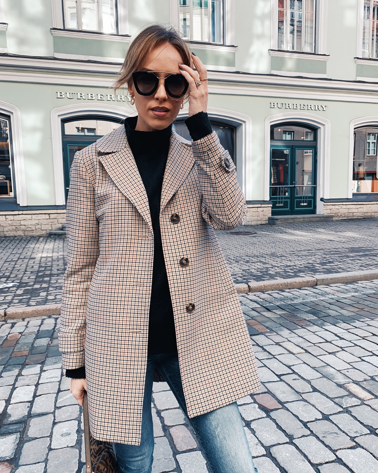 checked coat black sweater prada sunglasses spring outfit