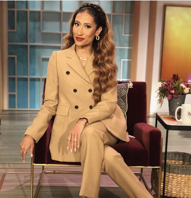 Elaine Welteroth wearing camel colored power suit on The Talk