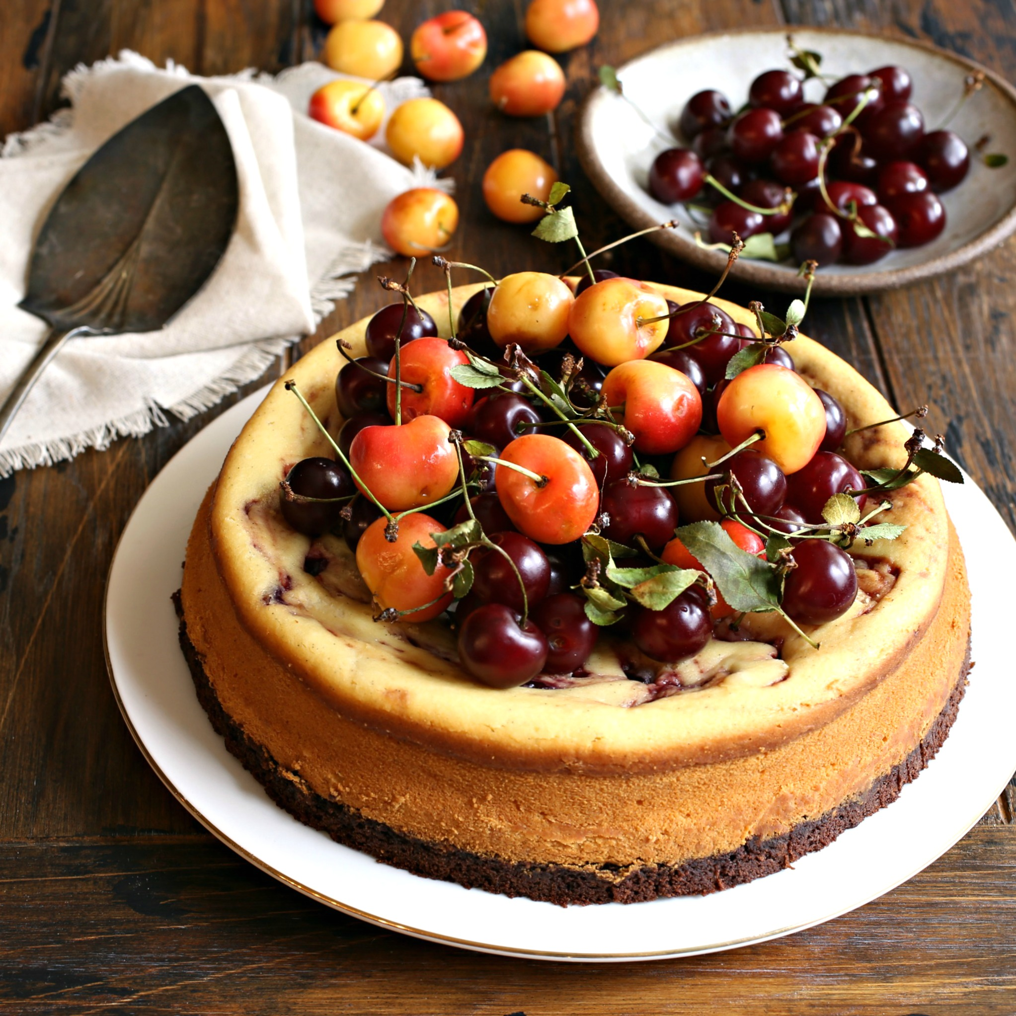 Recipe for cheesecake with a brownie base and cherry preserves swirl.