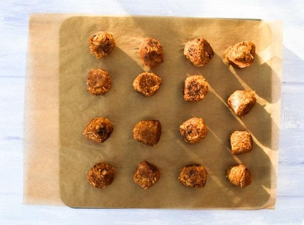 Vegan chickpea 'meatballs' on a baking sheet