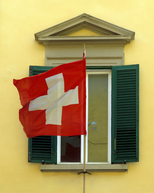 A Swiss flag outside a window, Via Ernesto Rossi, Livorno