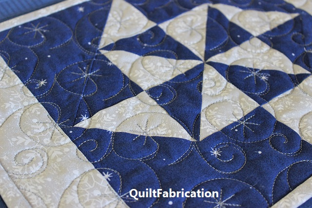 Holiday Star snowflake quilting by QuiltFabrication