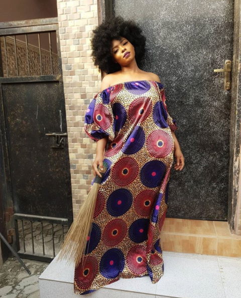 Yemi Alade shares a photo of herself holding a broom