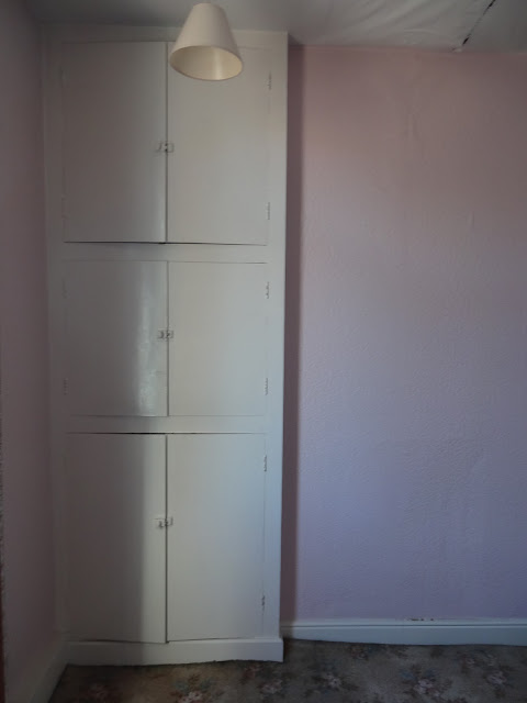 water tank cupboard in bedroom