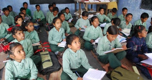 What is 'no detention' policy in RTE Act ?