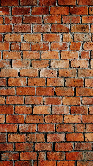 brick wall real photo in  ultra high resolution to use as phone wallpaper