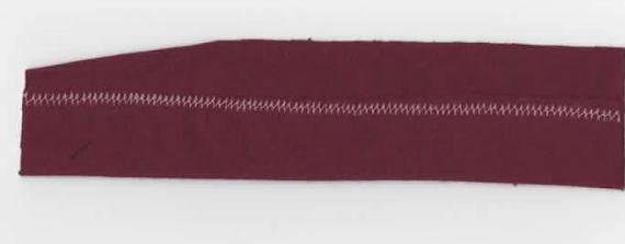 Kaksoisneulalla ompelu (nurja puoli)