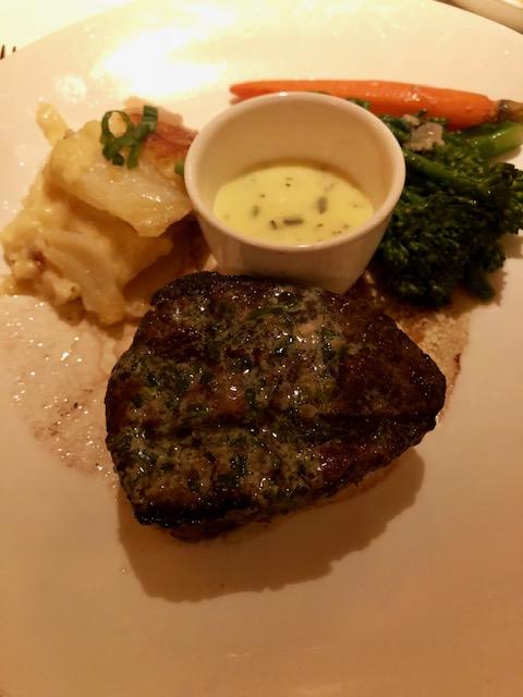 Steak with potatoes au gratin and saute'd veggies