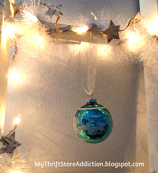 A Little Christmas Ladder and a Dear Gift mythriftstoreaddiction.blogspot.com Tinsel, sheet music star garland and vintage ornaments added to repurposed ladder