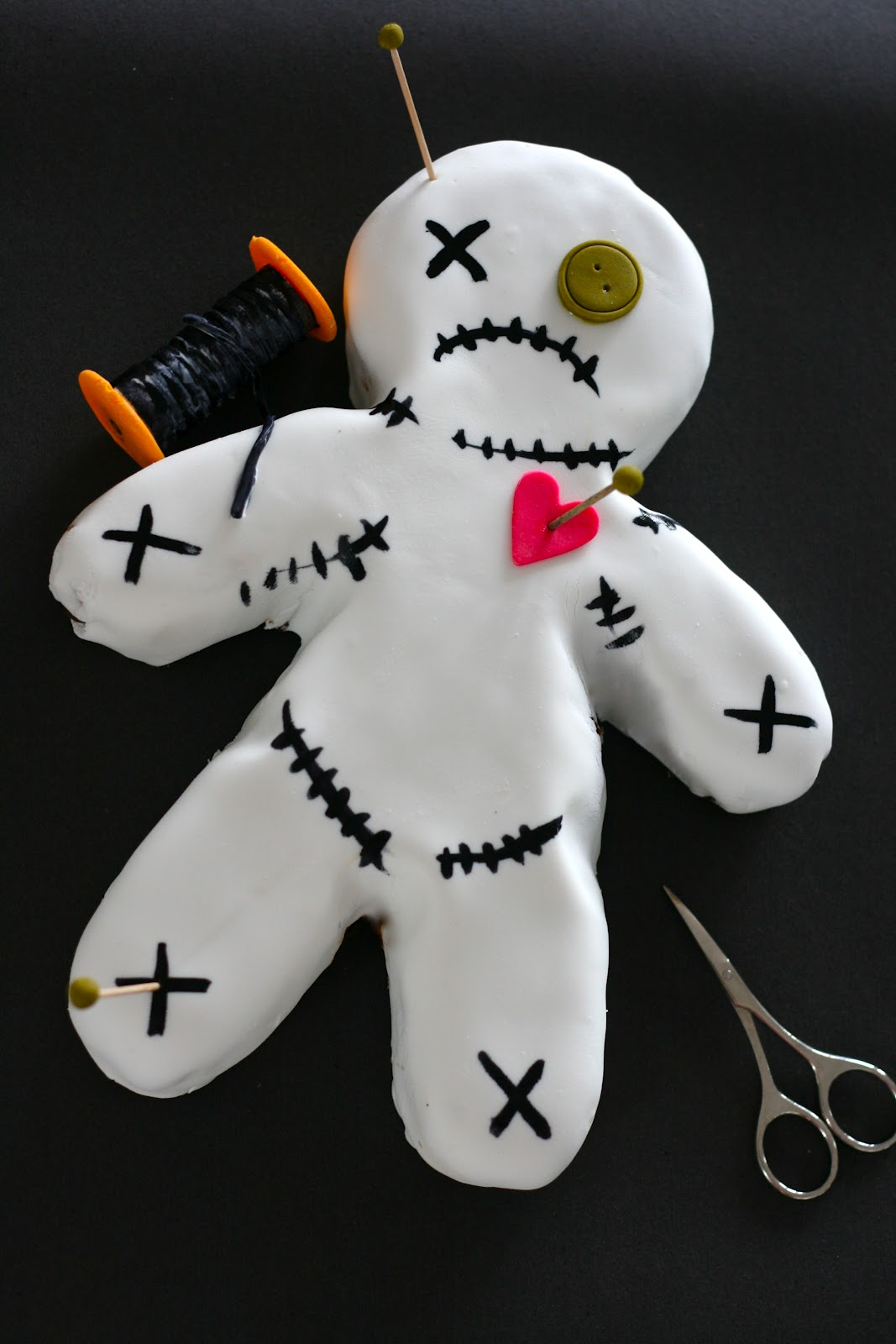 Millis kitchen Voodoo Doll Cake