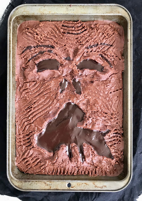 Close-up of a finished tray of brownies decorated and shaped to look like the Book of the Dead.
