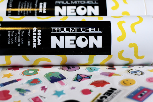Close up of Paul Mitchell Neon haircare set and stickers