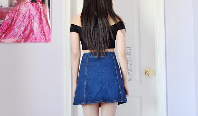 A simple outfit featuring a black off-shoulder crop top from Wholesalebuying and a Topshop-inspired blue denim button up A-line skirt.