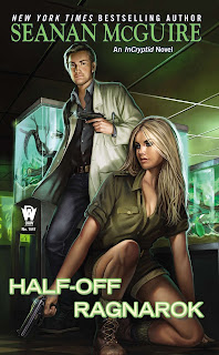 A young woman with long blonde hair and wearing a green shirt kneels in a half-crouch with a gun in her hand. Behind her, a blonde man in white lab coat is holding a gun as well. Behind them both are slightly glowing tanks, one has a tentacle draped over a branch.