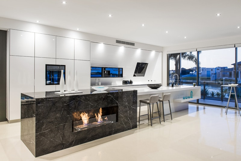 Kitchen Benchtops With Wooden Floors And White Cupboard