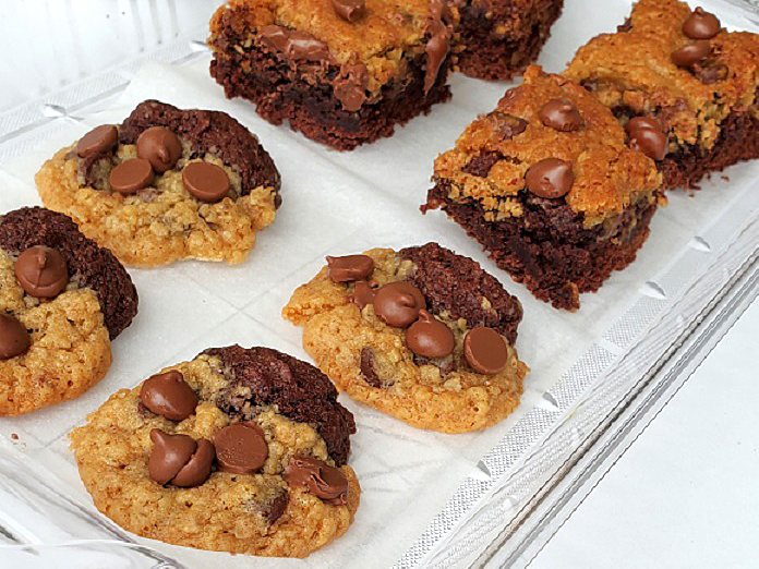 cookies and bars on a see through tray called cookie brookies half brownie, half chocolate chip cookies