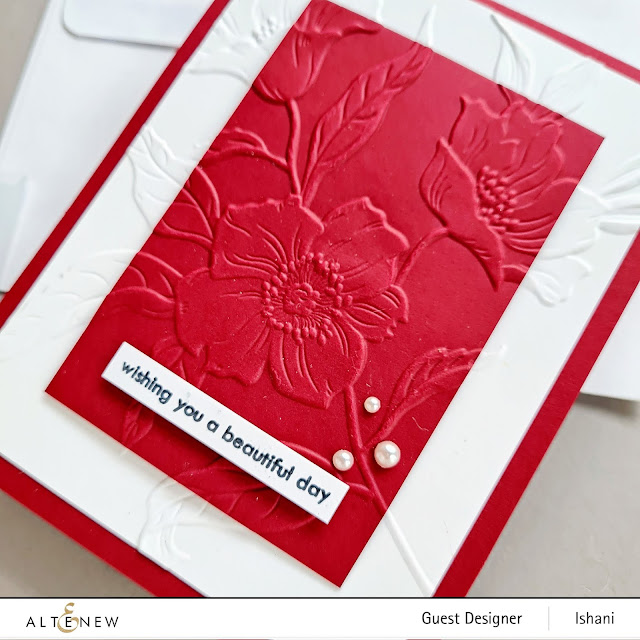 Video tutorial cardmaking with Hello Beautiful 3 D embossing folder card, Altenew Embossing folder floral card, crd with white and maroon cardstock, guest designer Ishani, quillish
