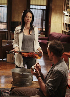 Jonny Lee Miller and Lucy Liu as Sherlock Holmes and Joan Watson in Elementary Episode # 2 While You Were Sleeping
