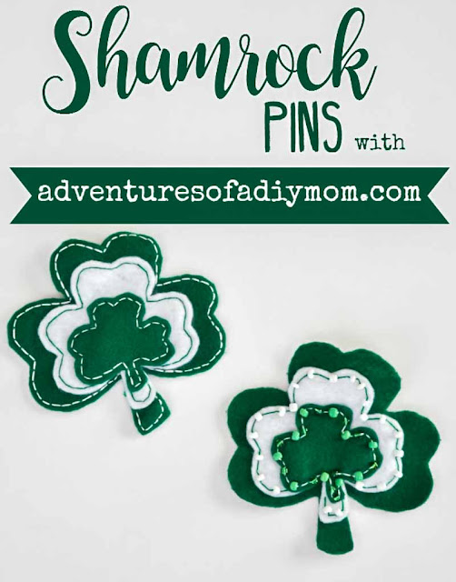 green and white shamrock pins