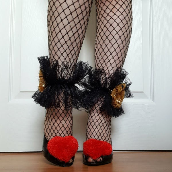 legs wearing fishnet tights with red fluffy heart peep toe shoes and black lace hand sewn ankle cuff