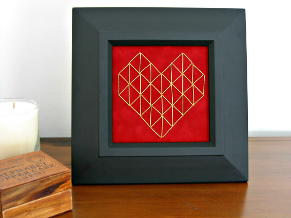 framed geometric heart stitched on red paper