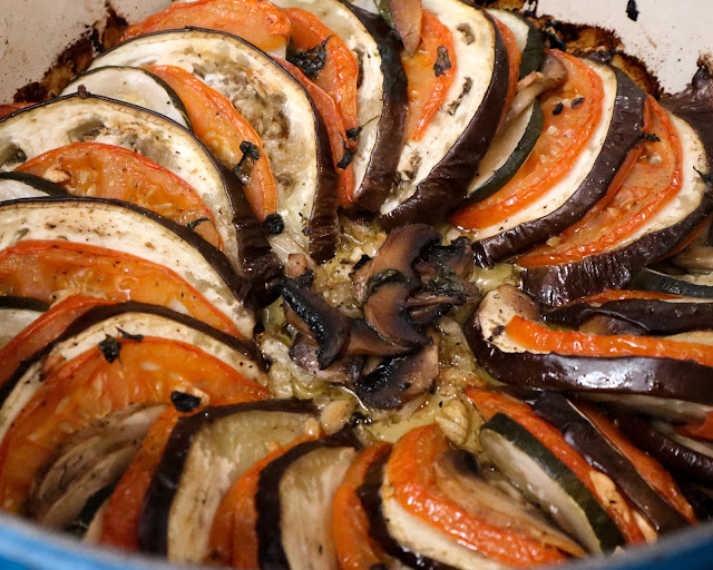 A baked tian showing caramelized eggplant, tomato, and zucchini softened in the oven.