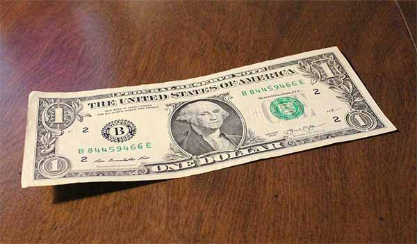 A 1 dollar note on the floor