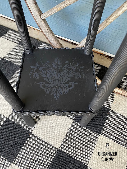 Photo of the stenciled bottom shelf of a plant stand/table