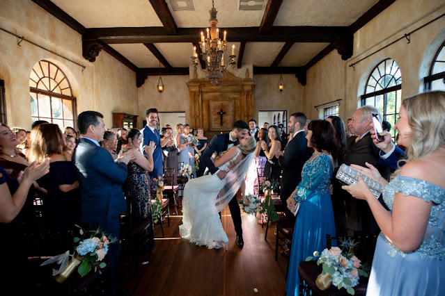 bride and groom kiss at the howey mansion