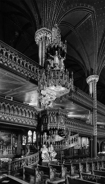 An alter and stairs inside the Basilique Notre-Dame de Montréal, in Montréal, QC.
