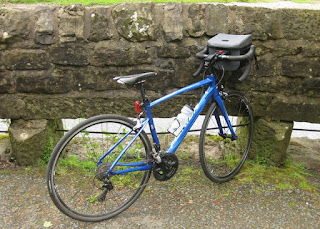 Merida Ride 400 road bike with handlebar bag