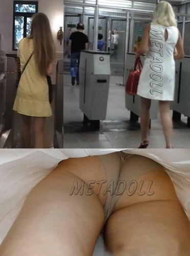 Upskirts 3113-3137 (Public upskirt voyeur takes his chance on the escalator)