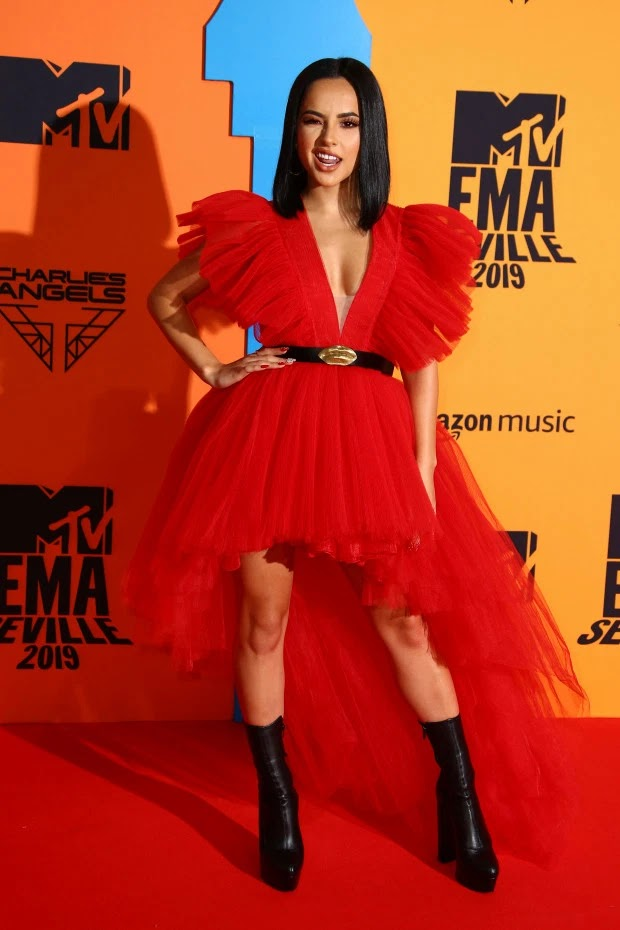 Becky G also opted for a red mini dress which she pared with chunky black boots