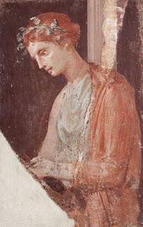pittura pompeiana: giovane donna immersa nella lettura