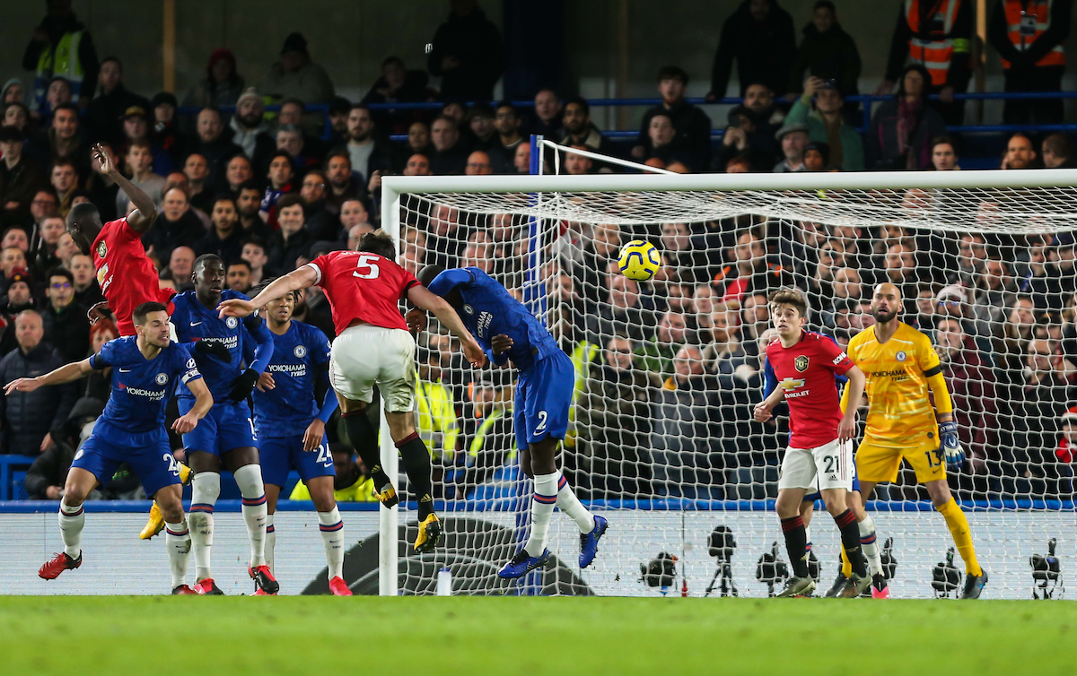 Harry Maguire scoring a header against Chelsea