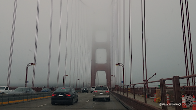 On the Golden Gate Bridge, facing south, with the south tower obscured by the fog