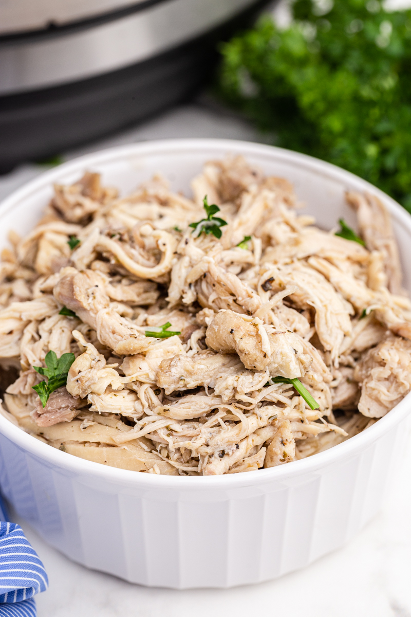 Instant Pot Shredded Chicken  in a white bowl.