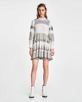 https://www.zara.com/pt/pt/vestido-curto-com-bordados-a-contrastar-p02903053.html?v1=5719524&v2=719020