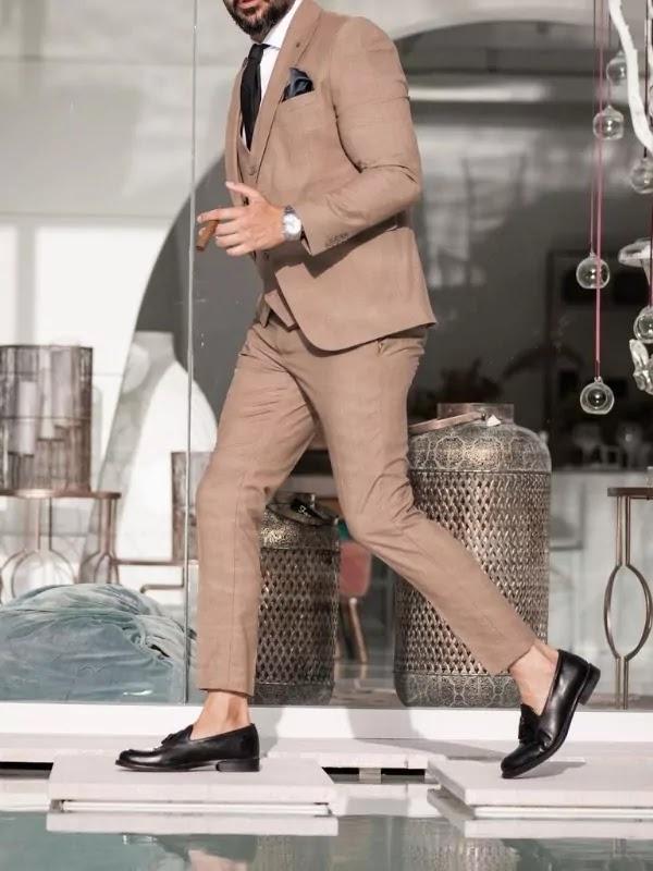 Tan suit colour with white shirt.