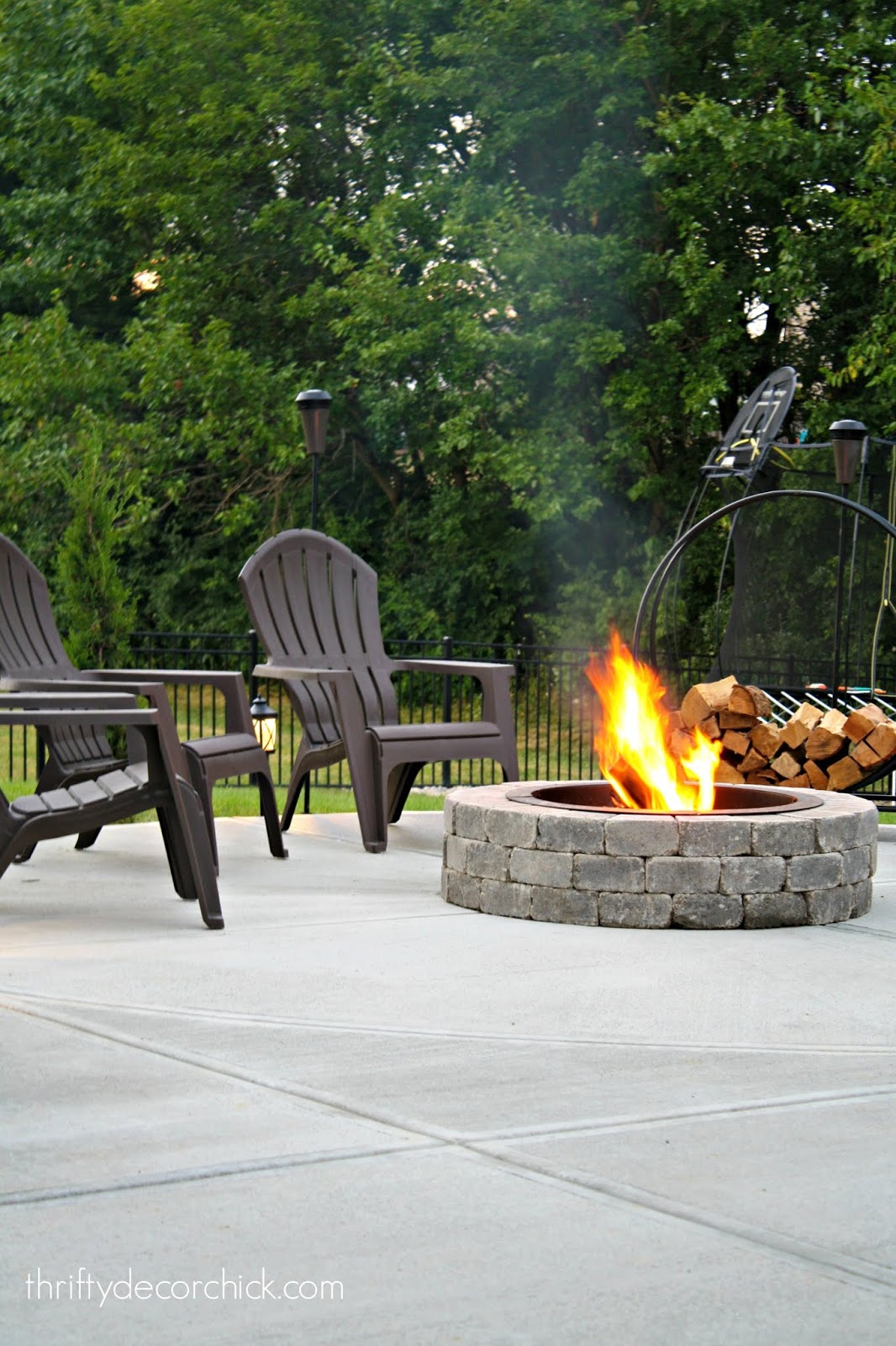 Adirondack chairs around fire pit on patio