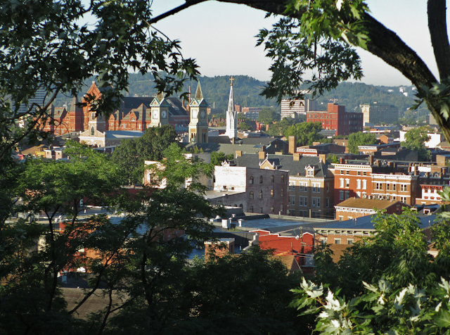 Over the Rhine neighborhood, Cincinnati, Ohio, showing rooftops and church spires and Music Hall
