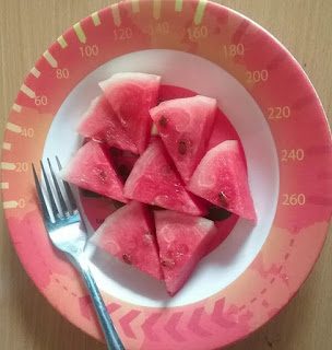sliced watermelon is good for our health because it contains fiber and water that will clean our digestive system