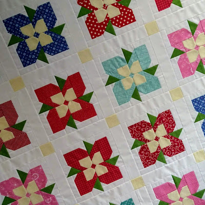 patchwork quilt top with flower blocks