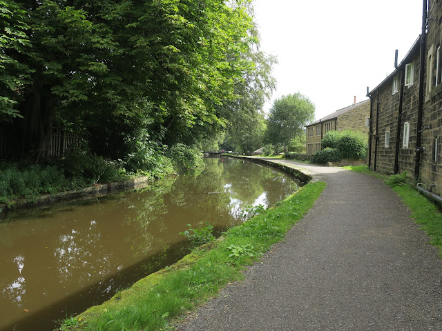 Canal with tow-path, lock gates and houses. Nr Mytholmroyd. Calderdale