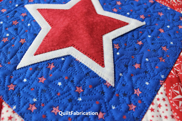 white and red stars on a blue background