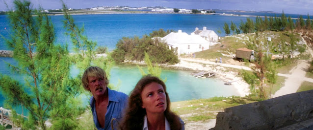 Jacqueline Bisset (as Gail Berke) and Nick Nolte (as David Sanders) at Coney Island, Bermuda in 1976 (Source Sony Pictures).