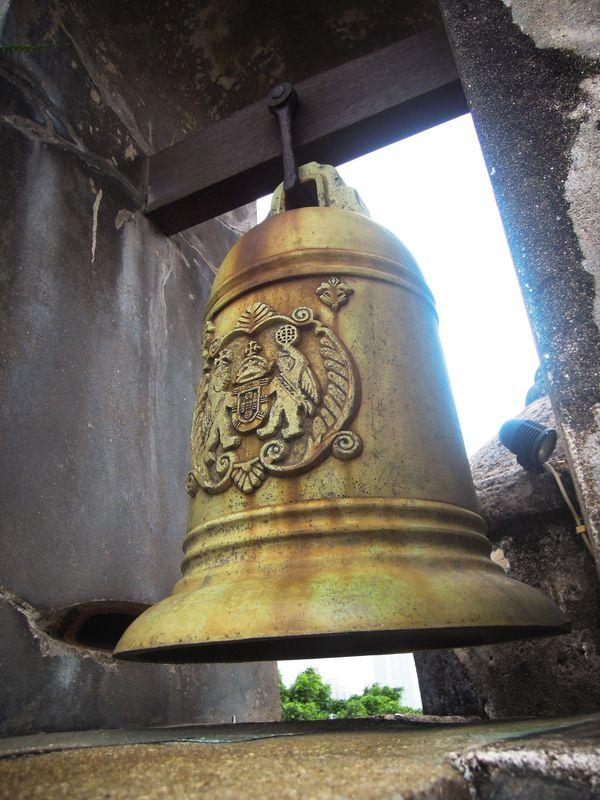 A bell hanging on the wall of Fortaleza do Monte in Macau