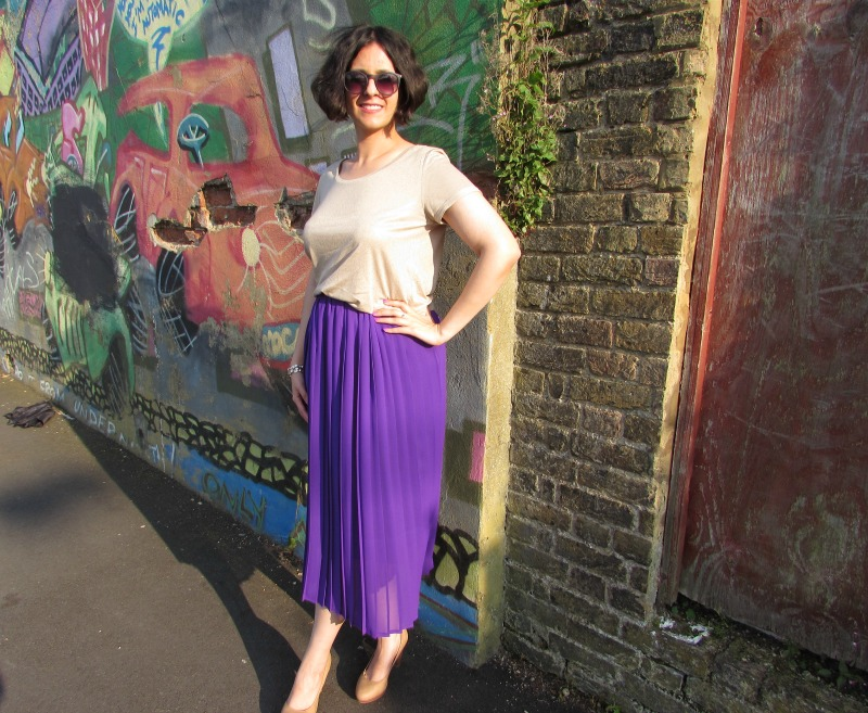 Beige metallic top and purple pleated skirt
